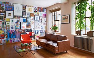 An inspirational mood board covers one whole wall of the living area