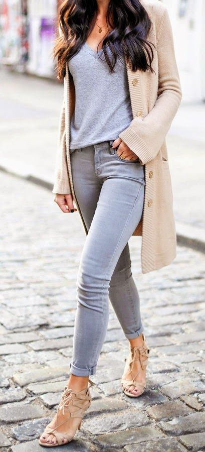 A long beige cardigan will ideally fit your casual V-neck tee tucked in light grey skinnies.: