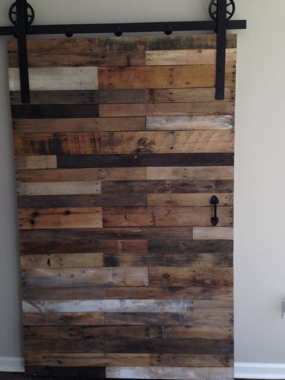 Pallet barn door naturally distressed handcrafted for Pallet wall on wheels