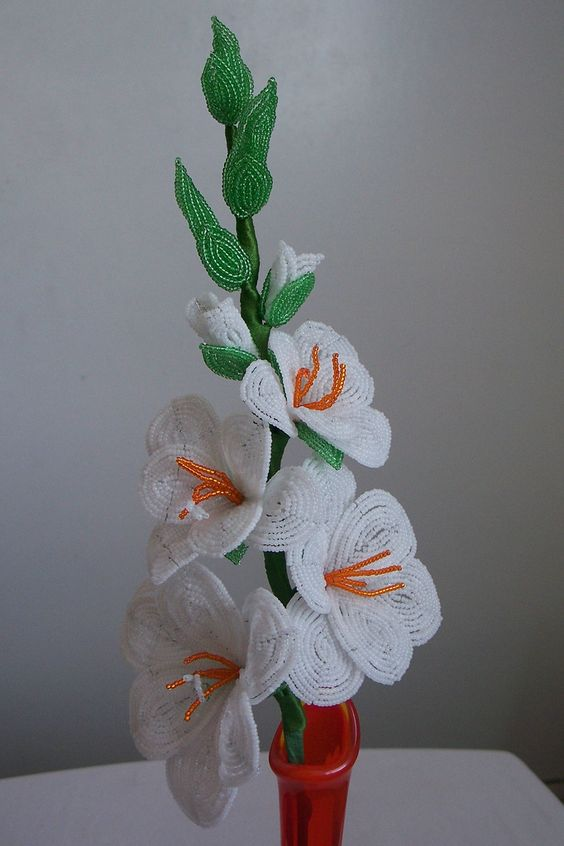 French beaded white and orange gladiola stem. Vase not included. Height: approximately 20