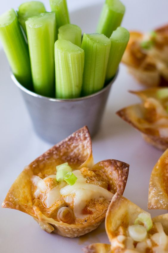 Buffalo Chicken Wonton Cups - all the spicy flavor of traditional wings, less the mess!