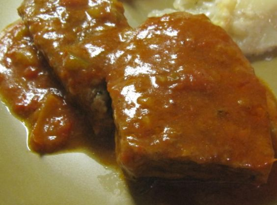 "I love swiss steak that you can cut with a fork. This recipe can be made in the oven, in a crock pot or on top of the stove depending on how low or slow you cook it.  You know it's done when you can ""cut it with a fork"""