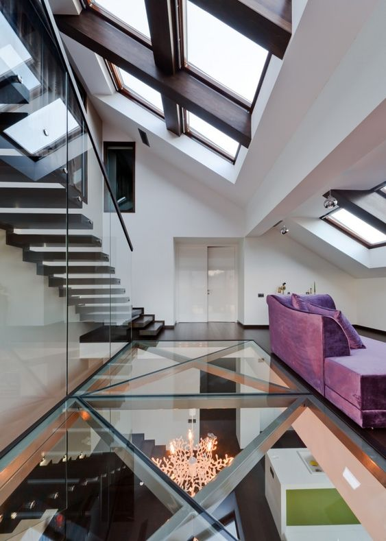 Cetatuia Loft in Brasov, Romania, by Ion Popusoi + Bogdan Preda. Interesting idea with the glass floor (bringing light down from the skylights), but love the crisscrossed metal beams even more.