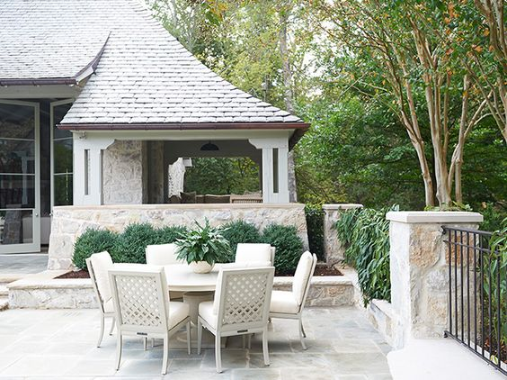 Outdoor dining furniture poolside at a traditional limestone house with interiors by Phoebe Howard. #outdoorliving #outdoordining #limestone #furniture
