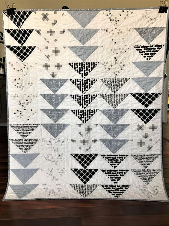 Black, white, and blue grey patchwork triangle quilt blanket baby toddler boy woodland animals rustic black and white nursery nest nursery