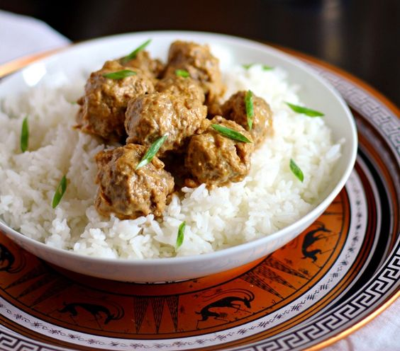 These Thai Curry-Coconut Meatballs are a total cinch to make - plus, they are crockpot-friendly and a HUGE hit with the guys for game day!