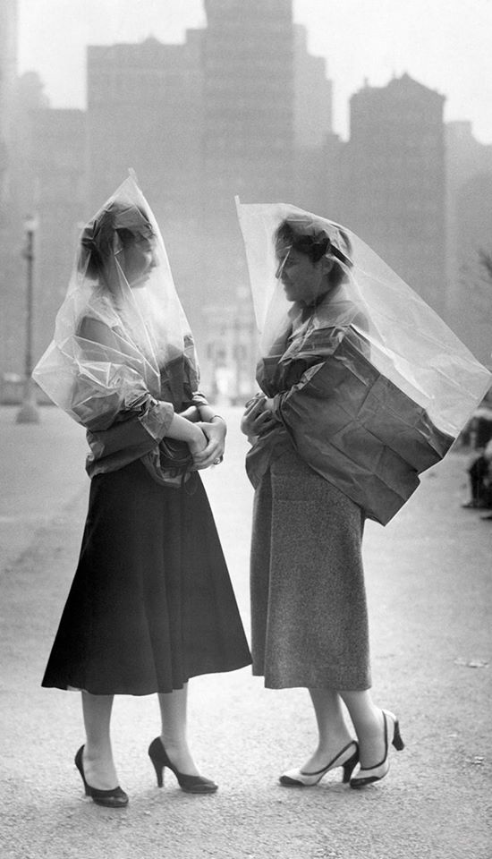 Women wearing war-surplus gas-capes to shield against smog in Philadelphia, Escaping the smog, 1953.