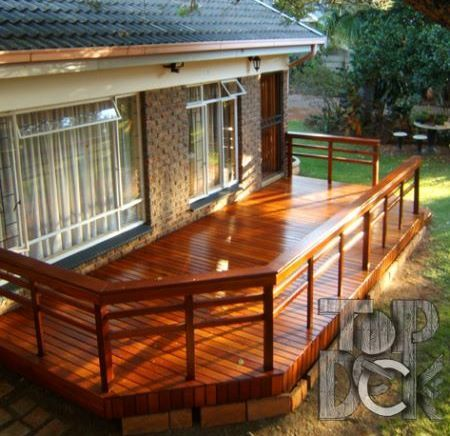 I'd love to have a sundeck like this! The stain of the wood is beautiful. It almost looks lacquered. Maybe I'll build one in the next few years. http://www.islanddeckmaster.ca