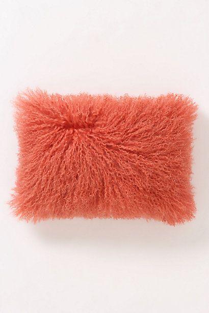 anthropologie's orange fleece flounce pillow