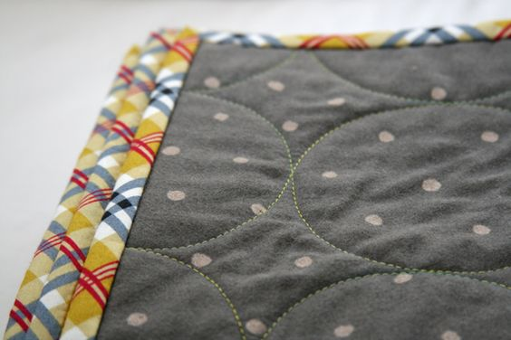 Whole cloth baby quilt with circle quilting