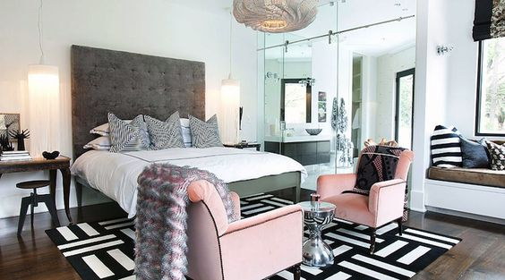bedrooms - FLOR Dashed Off- Jailbird Carpet Tiles built-in window seat pink velvet tufted chairs black trim hourglass tables tall gray tufted headboard chandeliers antique console tables nightstands industrial stools black white mitered pillows