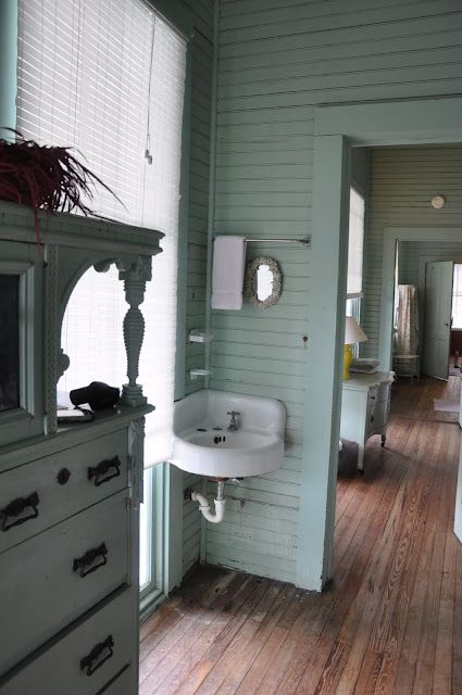 Jane Coslick Cottages.    Floors, walls, corner sink, a beach house filled with love and memories.