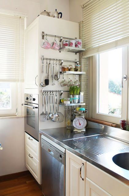 kitchen utensil storage - not on the counter, or crammed in a drawer. I like the easy accessibility of magnetic knife racks - this seems the same. Maybe Ikea?