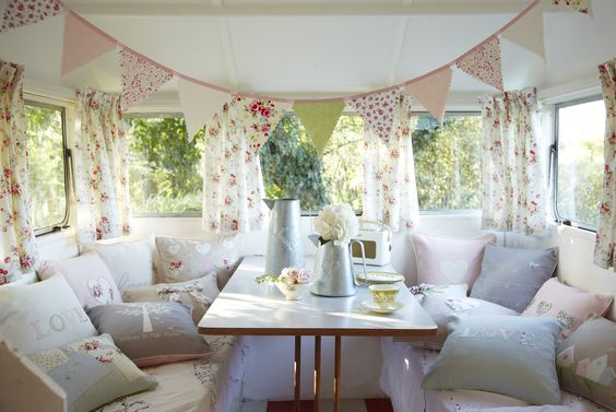 ...And Constance the vintage caravan on the inside, beautifully decked out in Retreat's Summer collection. So pretty and so welcoming!