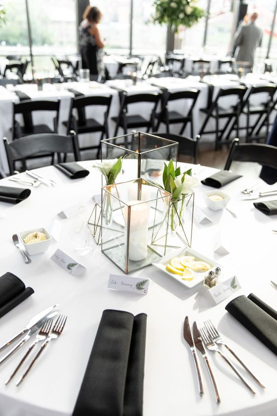 White Round Tables with a Black Chiffon Runner? 3