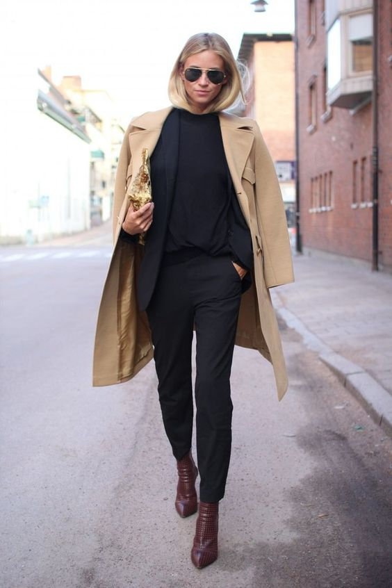 Office wear. Black trousers and camel coat: