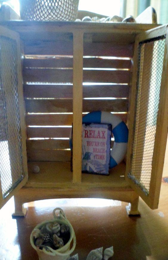 my beach cupboard on etsy - love the way the sun shines through the slats