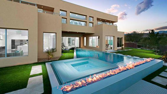 15 Dramatic Modern Pool Areas with Fire Pits | Modern pools, Spaces and  Modern