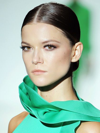 Loving these exaggerated lashes at Gucci's SS13 show.