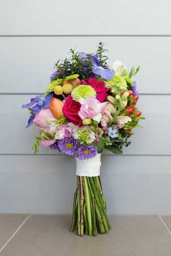 Wedding Magazine - Top 15 floral trends: a bright bouquet composed by pink roses, purple asters and iris, green chrysanthemums, red hypericum, yellow freesias and blue tweedia