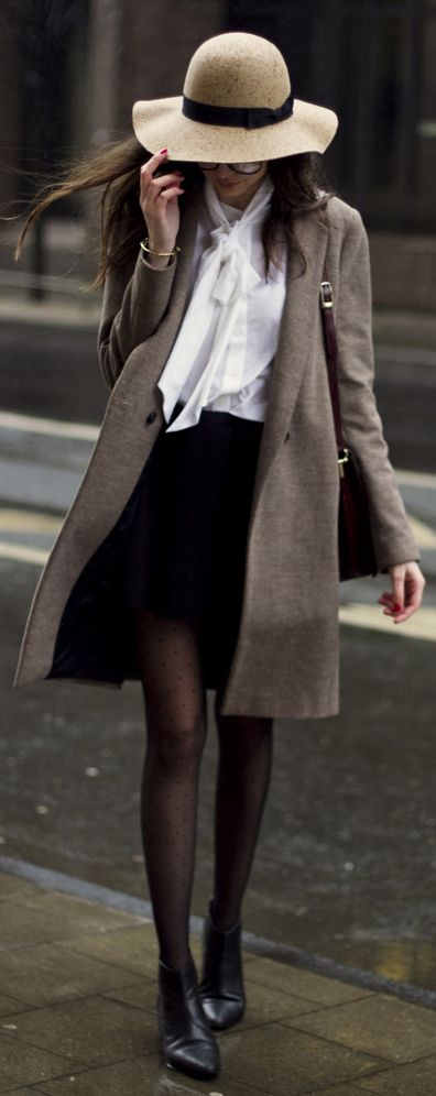 Via Just The Design: Beatrice is wearing a beige Zara mac coat with a white Gnossem blouse, the mini skirt from Asos and a Forever 21 floppy hat: