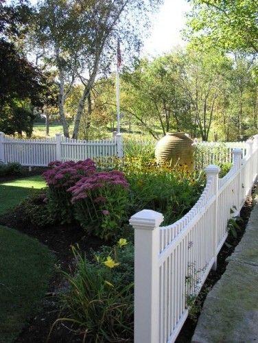 Perennials garden with white fence.