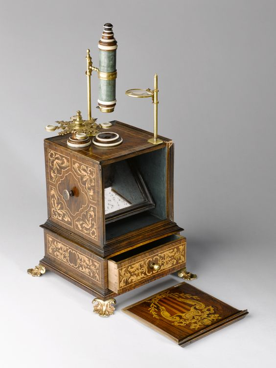 Chest microscope formerly owned by Pope Benedict XIV, Italy, 1701-1730  The high level of decoration reflects the status of this microscope's former owner, Pope Benedict XIV. This is an example of a chest microscope, which were popular from the mid 1700s and throughout the 1800s. The microscope folds into the chest, which protects the tube as well as making the microscope portable: