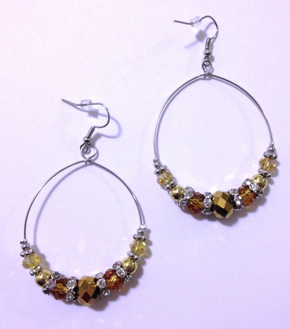 Gorgeous Gold Tone Bead Hoop Earrings. $8.99, via Etsy.