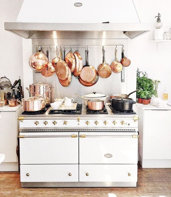 Oh my. Copper pots and white Lacanche range .