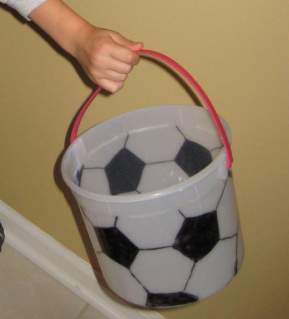 Soccer Ball Halloween Bucket - Dressing up as a soccer player for Halloween? Make an ice cream bucket look like a soccer ball by using a sharpie!