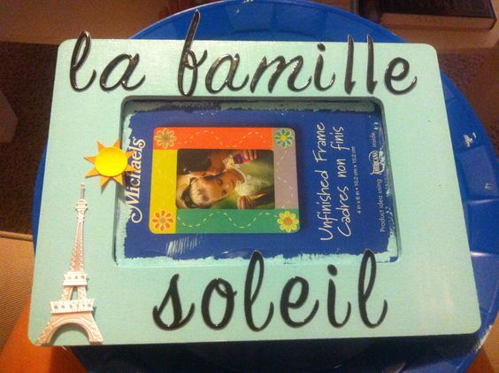 "Picture frame for my Big. It means ""the sun family"" in French. Hence the Eiffel Tower and sun :)"
