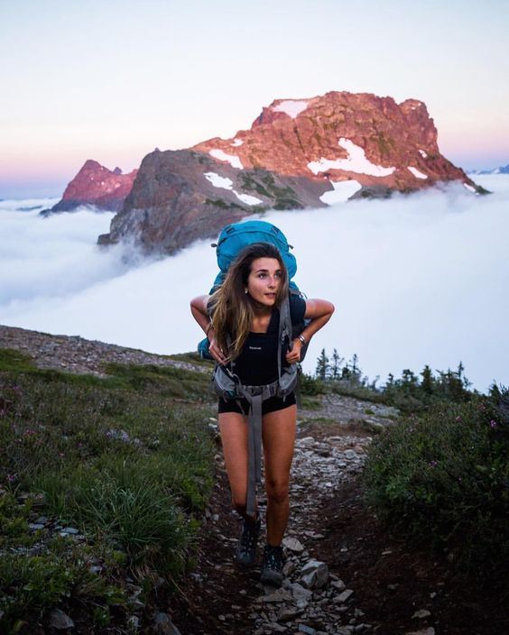 "Taylor Burk on Instagram: ""The hike started out under a gloomy sky with little hope that we would actually get to see the sunset. At one point not far from the top we made it above the clouds and got our first glimpse at the surrounding peaks. Words can't describe the feeling of how incredible it was up there, we were all yelling and screaming in excitement. Here's @hayoui on the move as we raced up the mountain."""