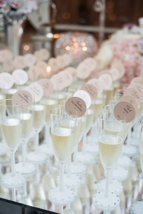 Wedding Escort Cards | Go beyond simple place cards and make your escort card display part of your wedding design.