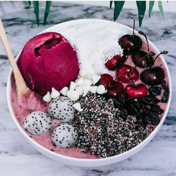 Cherry Bowl Simple recipe : For the base she blended frozen bananas and frozen pitted cherries. For the topping: coconut shreds,fresh cherries, dried cherries,rawnola,dragon fruit scooped out balls,vegan white chocolate chips and cherry sorbet.. Enjoy!: