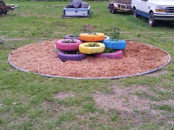 Herb Garden Using Recycled Tires And An Old Trampoline Mat