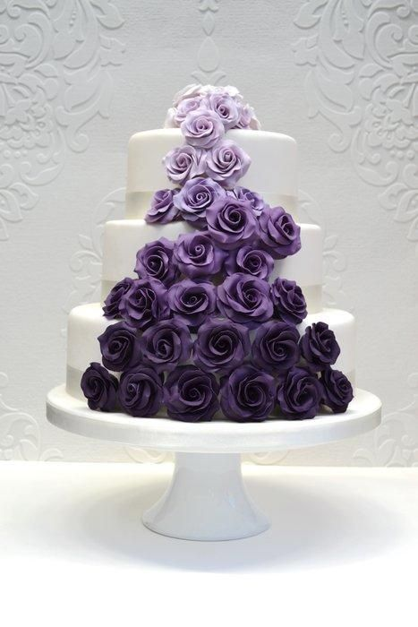 Here's a wedding cake design I did for a recent wedding fair we attended. Love making sugar roses.