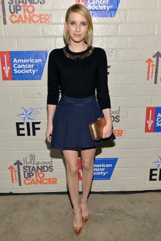 Emma Roberts in a Kate Spade bejewelled jumper with a navy skirt and Casadei heels at the Stand Up To Cancer event in LA