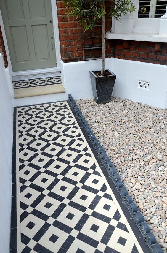 Plastered rendered front garden wall painted white metal wrought iron rail and gate victorian mosaic tile path in black and white scottish pebbles York stone balham london (57)