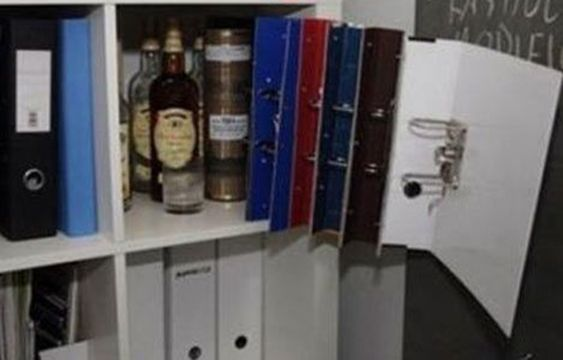 Binder Concealed Gun Storage | Gluing some binders together will create a void in your bookshelf to store your firearms #SurvivalLife www.SurvivalLife.com