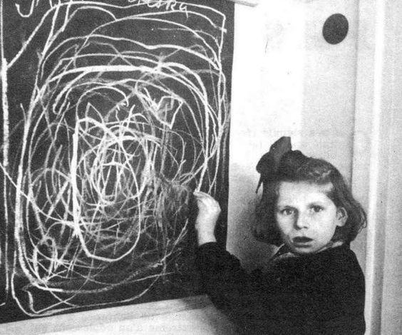 """Concentration Camp Survivor This is a little girl who grew up in a concentration camp drawing a picture of """"home"""" while living in a residence for disturbed children in Poland, 1948."""