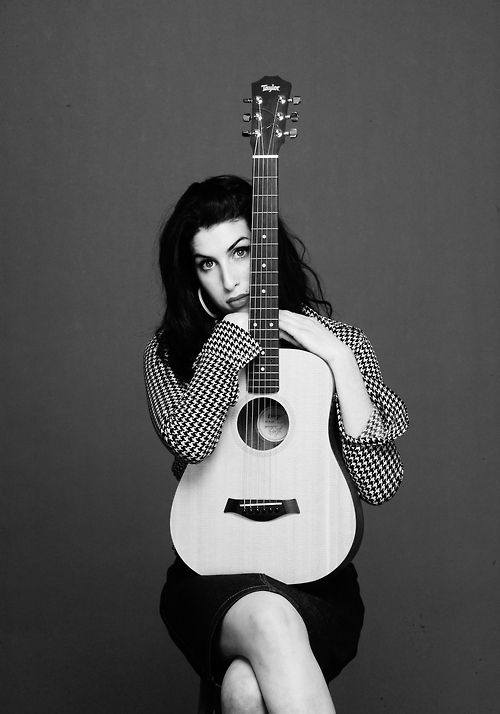 Amy Winehouse! How delicate she was in this photo. Young. Innocent. Full or…: