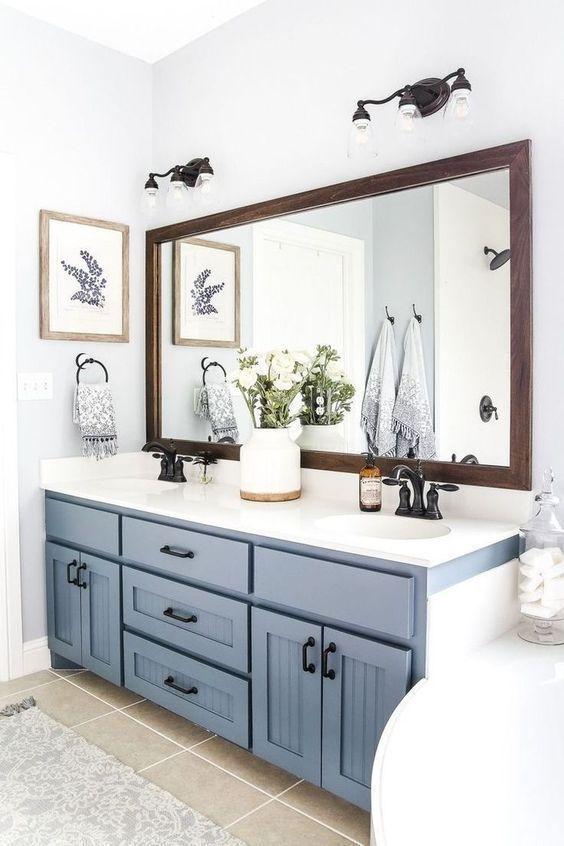 Cozy Farmhouse Bathroom With A Serenity Blue Vanity And A Tub Bathroom Remodel Master Small Farmhouse Bathroom Farmhouse Master Bathroom