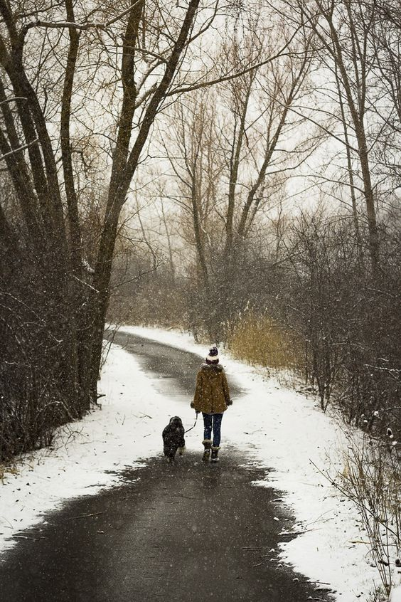 woman and dog walking down road in winter, spring snow #petphotography ©️The Right Moments Photography