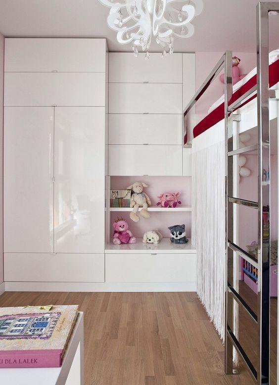 white gloss built in wardrobe in girl's bedroom