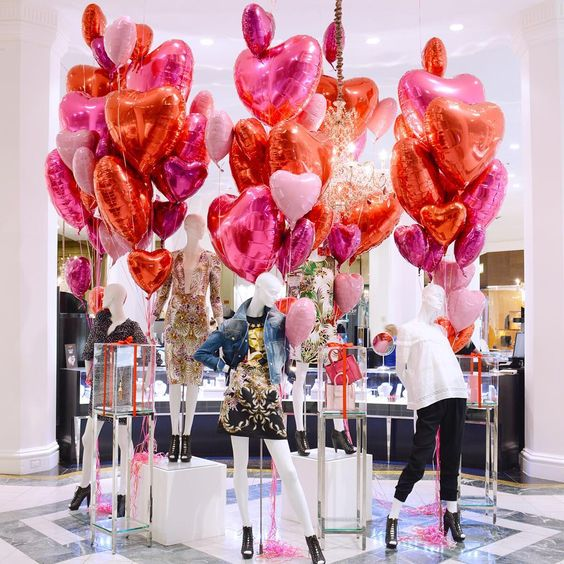 OGILVY | Fill your shop with fun & heart shaped balloons in pinks & red to get this look! #ValentinesDay #VisualMerchandising