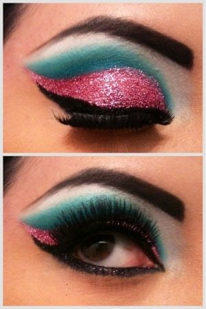 Pink glitter and blue eye shadow make up.