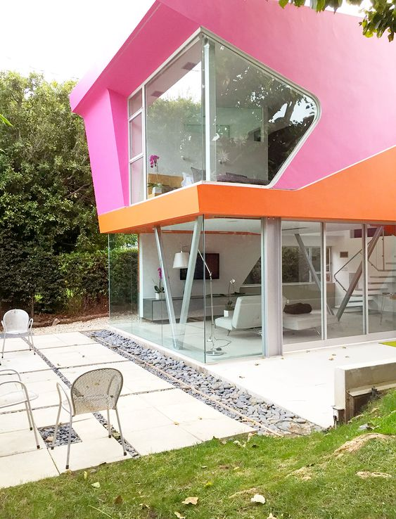 Outside of pink and orange modern home: