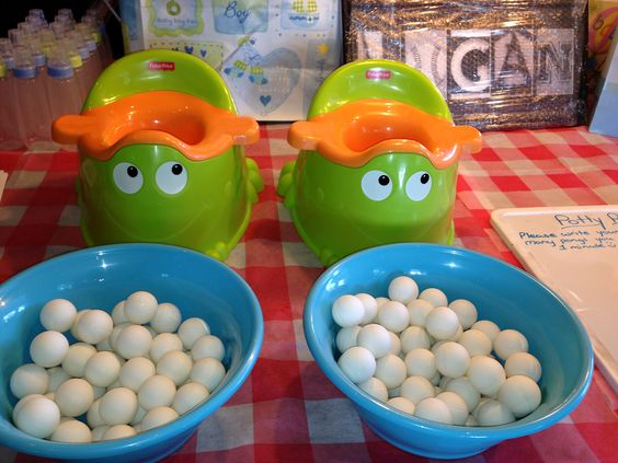 game potty pong who can get the most ping pong balls in the kiddie toilet man baby shower. Black Bedroom Furniture Sets. Home Design Ideas