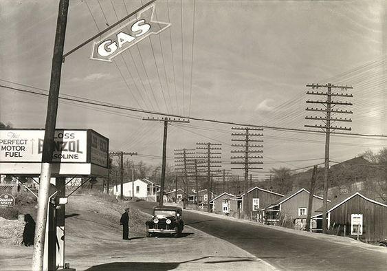 Walker Evans - Roadside Gas Station with Miner's Houses across Street, Lewisburg, Alabama (1935)