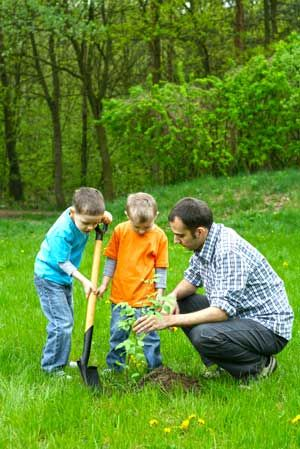 Children and Father Planting a Tree